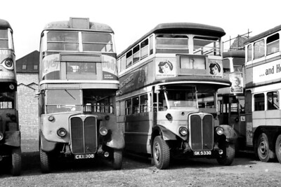 London Transport ST 518 and STL 1595 depicted before the former was consigned to Daniels of Rainham's scrapyard in September 1949. This is an undocumented negative but my guess as to the location would be Putney Bridge garage. [Mike Morant collection]