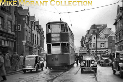 April 7th 1951 was the last day of London Transport tram services in Croydon and the LRTL chartered former LCC experimental car no. 1 for the day. Here we see no. 1 at the southernmost tip of the former 16 & 18 tram routes at Purley Cross on that dull and damp day. The Roofbox RT in the background is operating on route 197 to Norwood Junction whilst the depicted motor cars are a Ford Prefect on the left, a Series II Morris 8 Convertible and a 1932 Vauxhall Cadet parked. [Mike Morant collection]