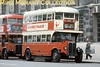 Preserved London Transport Tilling ST922 double-deck bus with outside staircase on heritage route 100 at Horse Guards Avenue in central London.<br> [<i>Slide taken by Mike Morant</i>]