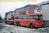 London Transport C2 class trolleybus no. 260 and Reading no. 113 stored alongside Smith's garage at Whitley near Reading in February 1963. What looks like snow was so compacted that the whole area visible here was solid ice.<br> [<i>Slide taken by Mike Morant</i>]