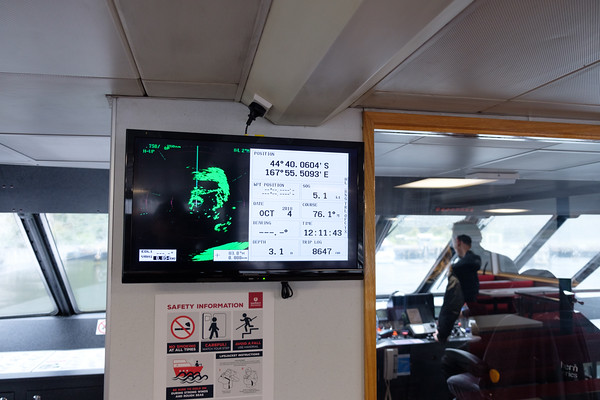 Navigation system and radar, with the Captain in the background on a boat on Milford Sound, South Island, New Zealand