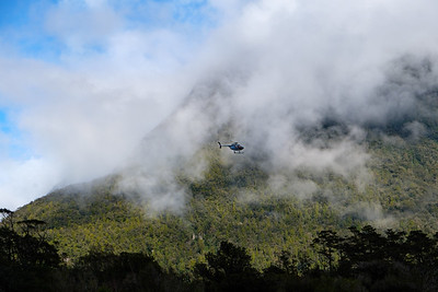 Tourist sightseeing helicopter flight over Milford Sound, Fjordland, South Island, New Zealand.