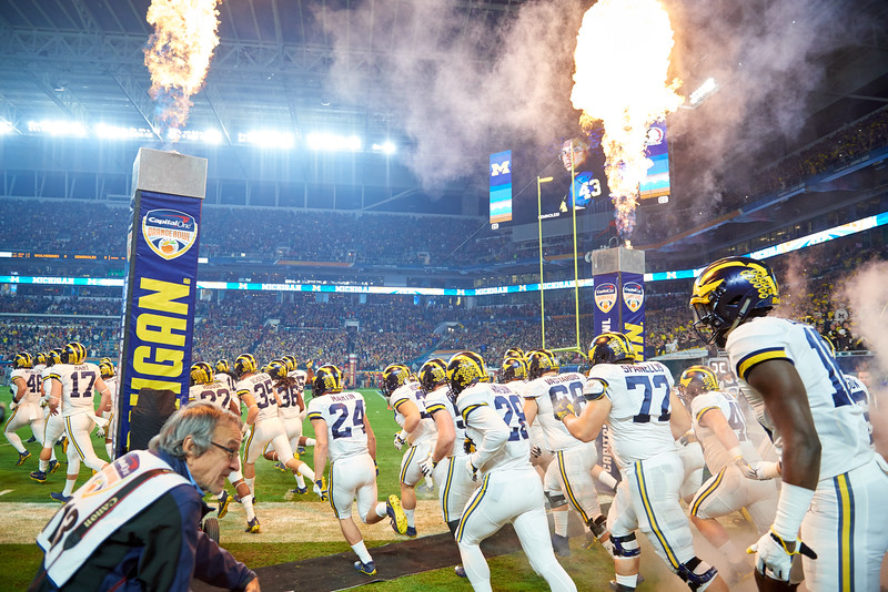 University of Michigan Wolverines take the field at the 2016 Orange Bowl