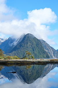 View over Milford Sound, Fjordland, New Zealand.  Peaks reflected in fjord.
