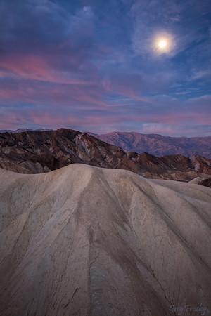 Setting moon at sunrise, Zabriskie Point, Death Valley Nat'l Park, CA