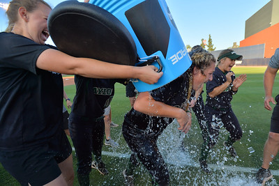 TUCSON, AZ - MAY 28:  Kelsee Selman (R) #16 of the Baylor Bears is given a celebratory ice bath after game three of the NCAA Div. I Super Regional against the Arizona Wildcats on May 26, 2017 at Hillenbrand Stadium in Tucson, Arizona. Baylor won 6-5 to advance to the Women's College World Series in Oklahoma City, Oklahoma.  (Photo by Sam Wasson)