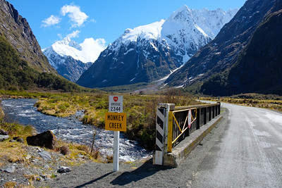View of bridge and mountains from Monkey Creek, Fjordland, South Island, New Zealand. State Highway 94.