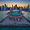 Navy Pier, Chicago, Illinois (March 2018)<br /> <br /> Why is it called Navy Pier?  I always wondered.  <br /> <br /> This pier was built in 1916 and was actually originally named Municipal Pier.  So where did the navy bit come in?  The name was changed in 1927 to honor naval veterans who served in World War I.<br /> <br /> While that is a wholly unsatisfying answer, there is an additional connection to the navy.  During World War II, the navy actually began using this pier.  It was a training center where about 10,000 people lived and worked.  There was everything from a 2,500-seat theatre, to various shops like barbers and tailors, to a hospital.  <br /> <br /> After that, the pier wasn't used very much and went into a decline.  It ultimately transformed into the attraction it is now during the 1980s and 1990s.  It is actually Chicago's number one tourist attraction.