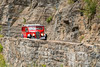 Historic Red Jammer Bus driving up the Going To The Sun Road to Logan Pass