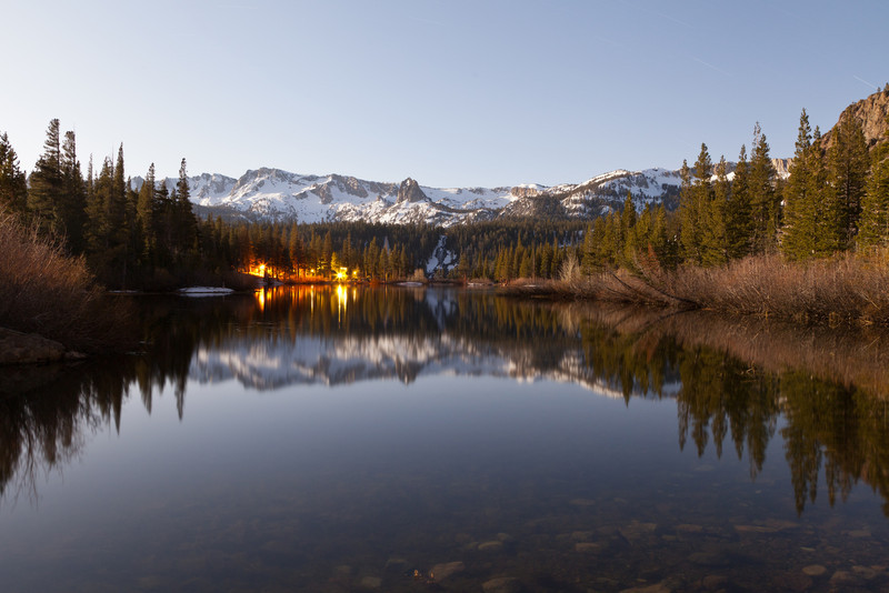 Twin Lakes in Mammoth at night illuminated by a full moon.