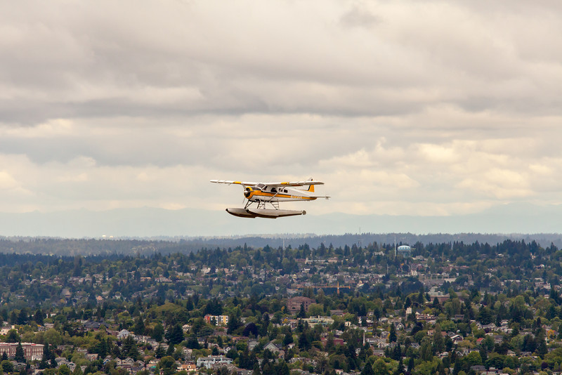 Water plane flying by-Seattle Space Needle viewing deck