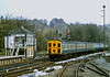 Class 207 DEMU No.1303 rolls into Oxted with a Victoria to East Grinstead service<br /> Preparations are clearly under way for the resignalling and electrification of the line which would mean the removal of the class from this route.<br /> <br /> 29 April 1986