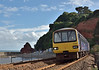 143620 emerges from Kennaway Tunnel into the late afternoon sun as it arrives in Dawlish with 2F47 1657 service from Paignton to Exmouth<br /> <br /> 3  August 2016