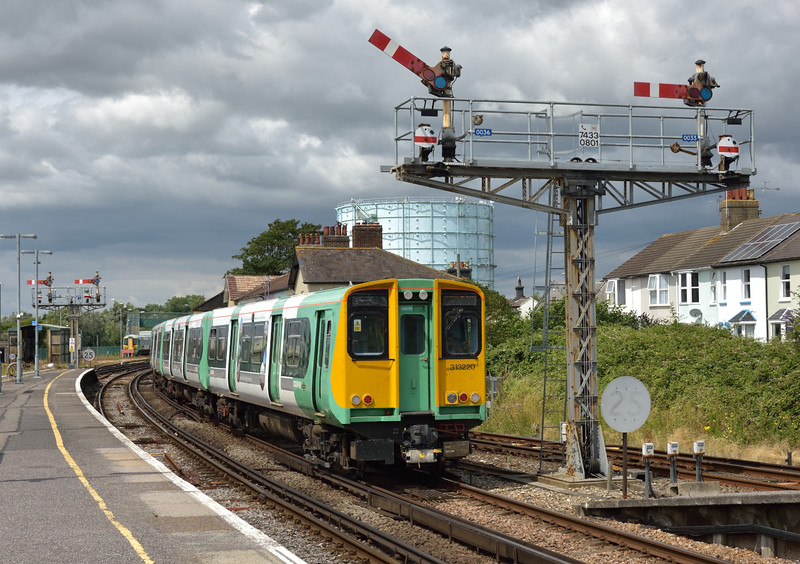 313220  leaves Littlehampton with 2N65 12.57 service to Portsmouth & Southsea passing the few remaining semaphore signals in the area.<br /> <br /> 26 July 2016