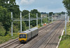 The OLE is appearing at Ruscombe and gradually eclipsing the view from Southbury Road bridge.<br /> Turbo 166206 in GWR green appears from neneath the spreading canopy with 2N36 12.27 from Paddington to Oxford<br /> <br /> 13 July 2016