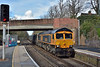 GBRf Class 66 No.66749 rolls through Virginia Water at the head of    4Y19 sand hoppers working from Mountfield Sidings  to Southampton W Docks  <br /> <br /> 22 March 2017