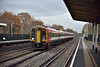 159009 glides through Hersham with 1L41 14.20 from London Waterloo to Exeter St Davids as I wait for the passing of 1Q53 in rapidly fading light.<br /> <br /> 23 November 2016