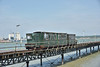 The 1917 built Brush loco is seen leading the train as it returns from the pier head to the Hythe terminus.<br /> <br /> The Hythe Pier Railway<br /> <br /> 14 June 2017