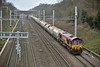 DB stickered Class 66 No.66145 gets another run out with 6M20 loaded hoppers from Whatley Quarry to Churchyard Sidings<br /> Seen here passing Southbury Lane in full dull!<br /> <br /> 16 March 2017