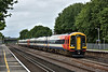 The Class 159's continue to give sterling service on the SWML<br /> 159011 leads through Byfleet & New Haw with 1L26 0.641 service from Exeter St Davids to London Waterloo<br /> <br /> 5 August 2015