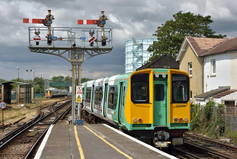 313214 reverses away from Littlehampton as 5S62 ECS working from Barnham to Littlehampton Shed<br /> <br /> 26 July 2016