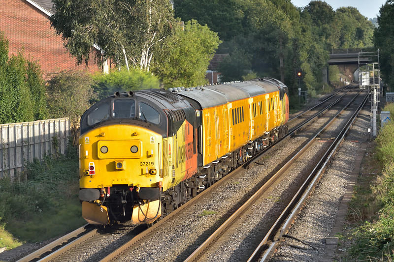 Colas Class 37 No.37219 passes St Johns Way Chertsey on the rear of 1Q51 Network Rail test train from Derby to Eastleigh Works <br /> <br /> 26 September 2016