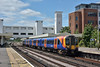 450556  speeds through Platform 2 at Surbiton with 1T38 10.59 from Portsmouth Harbour to London Waterloo<br /> <br /> 23 June 2017