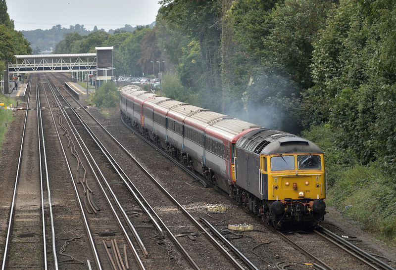 Rail Operation Group Class 47 No.47815 turns on the power as it accelerates away from West Byfleet hauling former GatEx units Nos. 2404 + 2409 working as 5O86 from Ely Papworth Sidings to Bournemouth T&R.S.M.D<br /> <br /> 7 September 2017