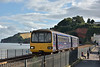 Evening sunshine just catches 143603 as it draws into Dawlish station with service 2F49 the 17.26  from Paignton to Exmouth<br /> <br /> 3 August 2016