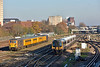444006  speeds through Woking with 1W67 13.05 service from Waterloo to Weymouth<br /> Stabled in the yard are GBRf 'Super' ED's 73961 tnt 73964 with a Network Rail test train<br /> <br /> 1 December 2016