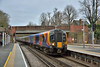 Desiro 450564  rolls to a halt at Virginia Water with 2C39 13.50  from  Waterloo to Reading<br /> The recent removal of the old lattice footbridge has actually cleaned up the background at this end of the platform.<br /> <br /> 14 March 2017