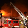 Atlantic Incident (LACoFD) : 5/21/15: 3rd Alarm Commercial Structure Fire, 7617 S Atlantic Ave (Cudahy), Former Club Caribe Casino, 1 story approximately 100'x100' irregular, fully involved with fire. Approximately 30 minutes into the incident as crews were transitioning to a defensive mode, Four members of Truck 164 engaged in ventilation operations rode the roof down during a collapse.  A mayday was called and the firefighters were extricated approximately five minutes later.  Time of alarm 23:38 hours