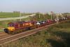 20 April 2018. Automotive locomotive as 66154 leads the 6X77 1354 Dagenham - Mossend through Castlethorpe on a beautiful sunny evening.