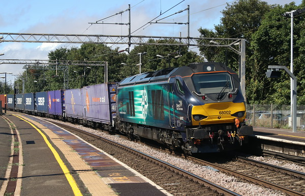 10 August 2018. Making a change from the usual diet of a DRS 66, 68002 Intrepid hums through Wolverton leading the 4L48 1406 Daventry - Purfleet. Dedicated to my nephew Charlie Roberts on the occasion of his 16th birthday.