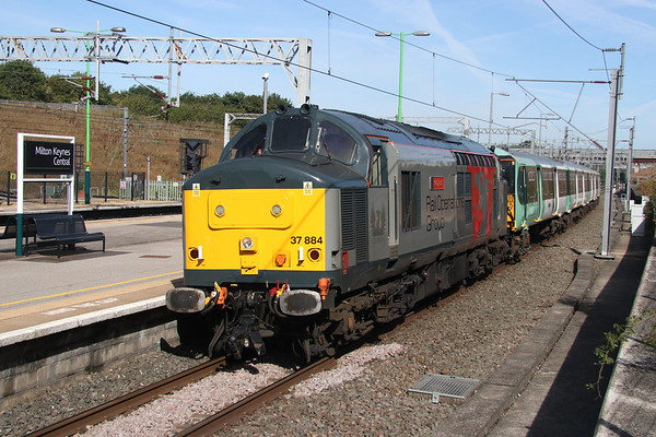 11 August 2018. 37884 Cepheus has 455814 for company passing through MKC with the 5O88 0855 Wolverton Centre Sidings - Stewarts Lane T&RSMD.