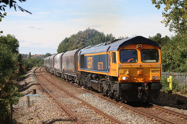 11 August 2018. 66770 approaches Bow Brickhill on the first few miles of her journey working the 4H03 1027 Bletchley Cemex  - Peak Forest stone empties.