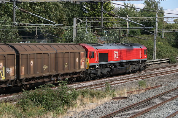 3 August 2018. DB red 66150 heads south at Castlethorpe leading the 1506 Daventry - Dollands Moor.