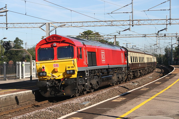 11 August 2018. With 66060 leading out of sight, a smart 66135 brings up the rear of the 'Walsall Concerto', the 1Z33 0727 Euston - Birch Coppice passing Wolverton.