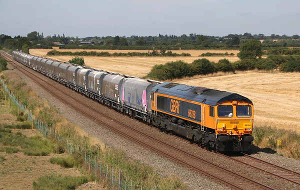 4 August 2018. GBRf have taken over operation of the Bletchley stone traffic from Peak Forest from the beginning of August. Recently renumbered from 66238, new GBRf acquisition 66788 passes Husborne Crawley with the 4H03 1016 Bletchley Cemex - Peak Forest empties.