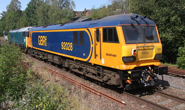 11 August 2018. 50008 Thunderer tows GBRf 92028 through Fenny Stratford whilst working the 0Z81 0936 Loughborough Brush - Wembley. 92028 is the fifth GB 92 to have received CAF mods and Dellner couplers (as seen here) to be able to work with the new Mark 5 sleeper stock.