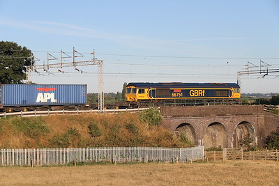 11 August 2018. Having worked previously in Poland, Germany and the Netherlands before being acquired by GBRf in 2013, 66751  Inspiration Delivered Hitachi Rail Europe  passes Three Arches, Castlethorpe working 4M21 0315 Felixstowe - Trafford Park.