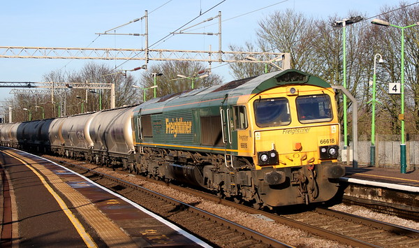 24 December 2018. Diverted from her usual MML route, 66618 Railways Illustrated Annual Photographic Awards Alan Barnes passes Wolverton with the 6L45 Earles - Dagenham cement working.
