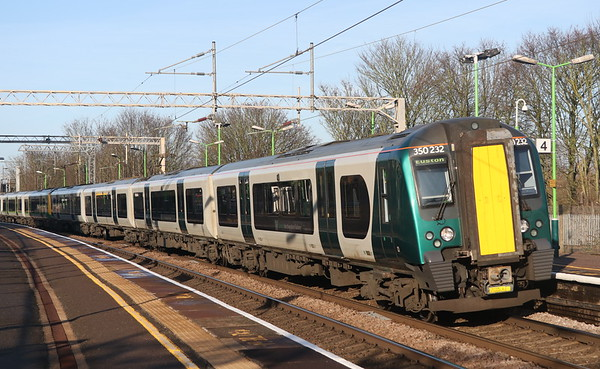 24 December 2018. Reliveried 350232 leads sisters 350250 + 350242 into Wolverton on the 2Y32 1054 BNS - Euston.