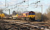 4 February 2017. A mixed bag of a consist sees 66060 approach Wolverton leading the 6X07 1221 Bescot -Harlesden.
