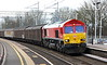 24 February 2017. DB red 66150 curves through Woverton with the 6A42 1447 Daventry - Wembley vans.