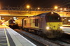 18 February 2017. 67022 is seen under the station lights at MK with the return leg of 'The Midland Meanderer', the 1Z69 1736 Stratford upon Avon - Euston. 350232 Chad Varah is seen in platform 5 about to form a service for Euston.