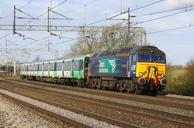 17 February 2018. 57303 Pride of Carlisle ran light from Crewe Gresty Bridge to Wolverton Centre Sidings to collect 455816 for onward movement south. Having arrived late from Crewe, 57303 and the 455 are seen here passing Chelmscote with the 5Q55 0905 Wolverton Centre Sidings - Stewarts Lane T&RSMD running 119 minutes late.