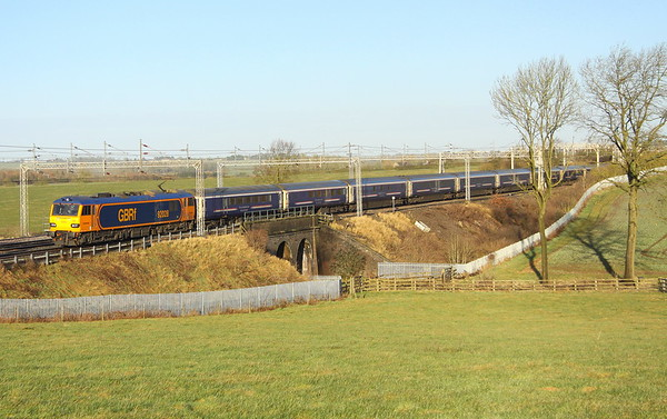 15 February 2018. Formerly named Saint Saens, GBRf operated 92028 crosses Three Arches on the approach to Castlethorpe with the late running 1M16 2045 Inverness - Euston sleeper. The service was delayed around the Carnforth area due to overhead line issues and is seen here 110 late running on the slow line having crossed from the fast minutes earlier at Hanslope Junction.