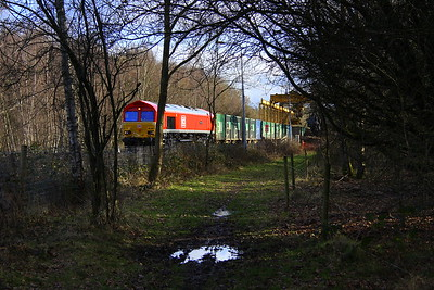 9 February 2018. A view of DB red 66035 Resourceful in amongst the trees at Calvert with the photo taken from the public bridlepath.