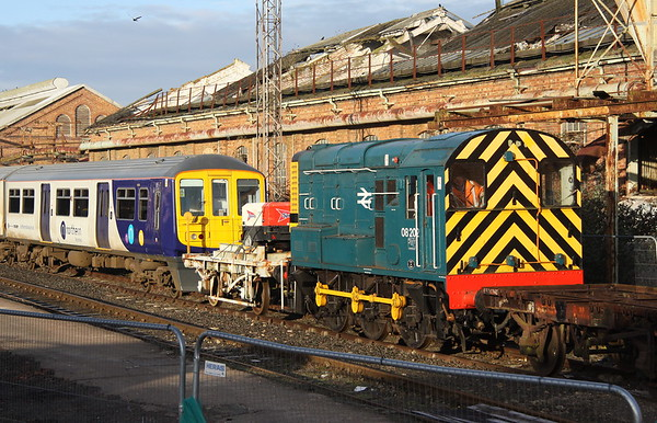 17 February 2018. BR blue 08202 is seen inside Wolverton Works shunting Northern Rail 319363 (and out of sight 319448). The pair of 319's later forming the 1010 departure from Wolverton Centre Sidings to Allerton depot.